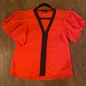 Red and black Vici top. Size Small.